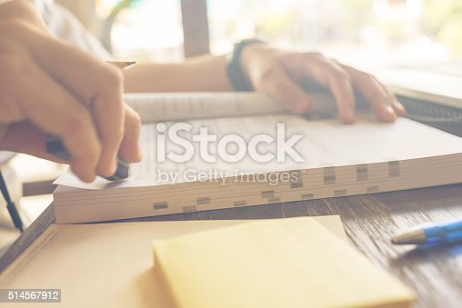 470761441 istock photo Close-up of human hand erasing notes on the book 514567912