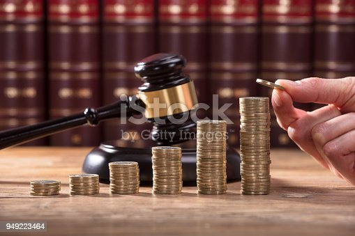 istock Close-up Of Human Hand Placing A Coin 949223464