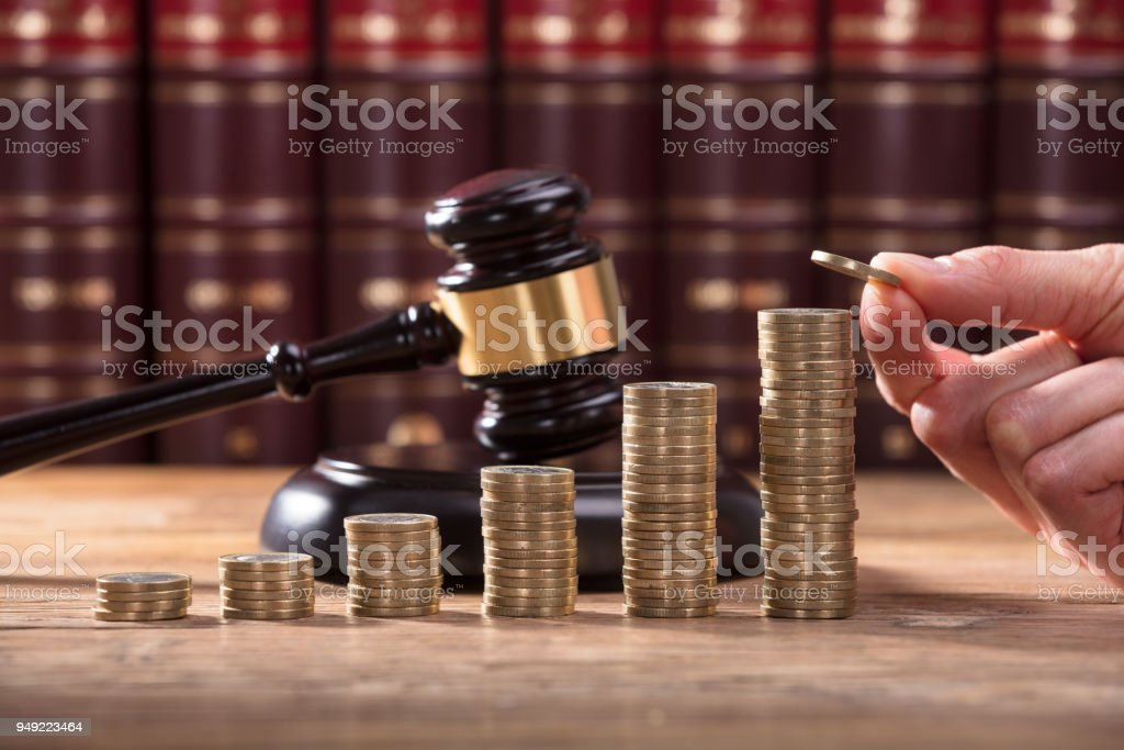 Close-up Of Human Hand Placing A Coin stock photo