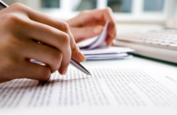 Close-up of human hands doing paperwork stock photo