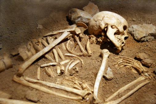 human bones of someone curled in a grave
