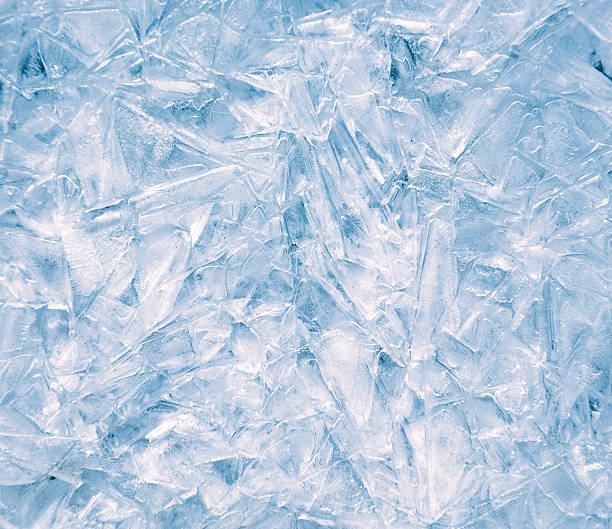 close-up of ice surface, abstract background. - ice crystal stock pictures, royalty-free photos & images