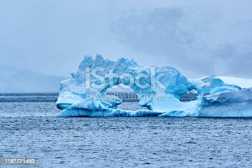 Close-up of icebergs floating on seawater, Paradise Bay, Antarctica.