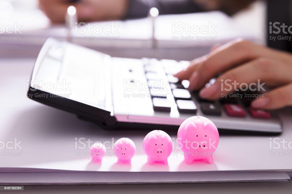 Close-up Of Increasing Pink Piggybank stock photo