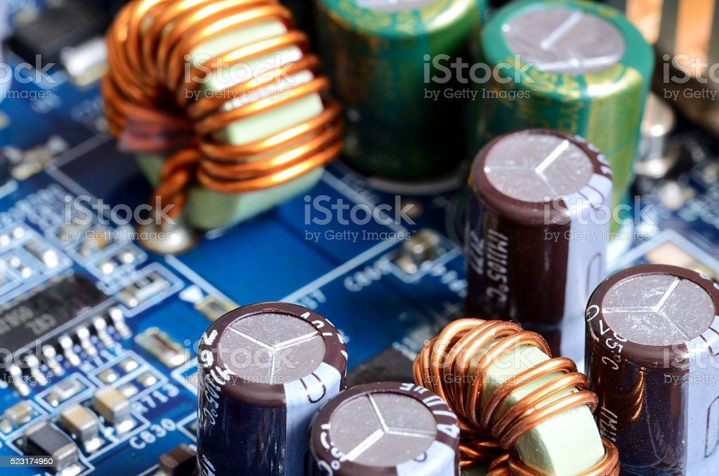 Close-up of inductors, capacitors and chips stock photo