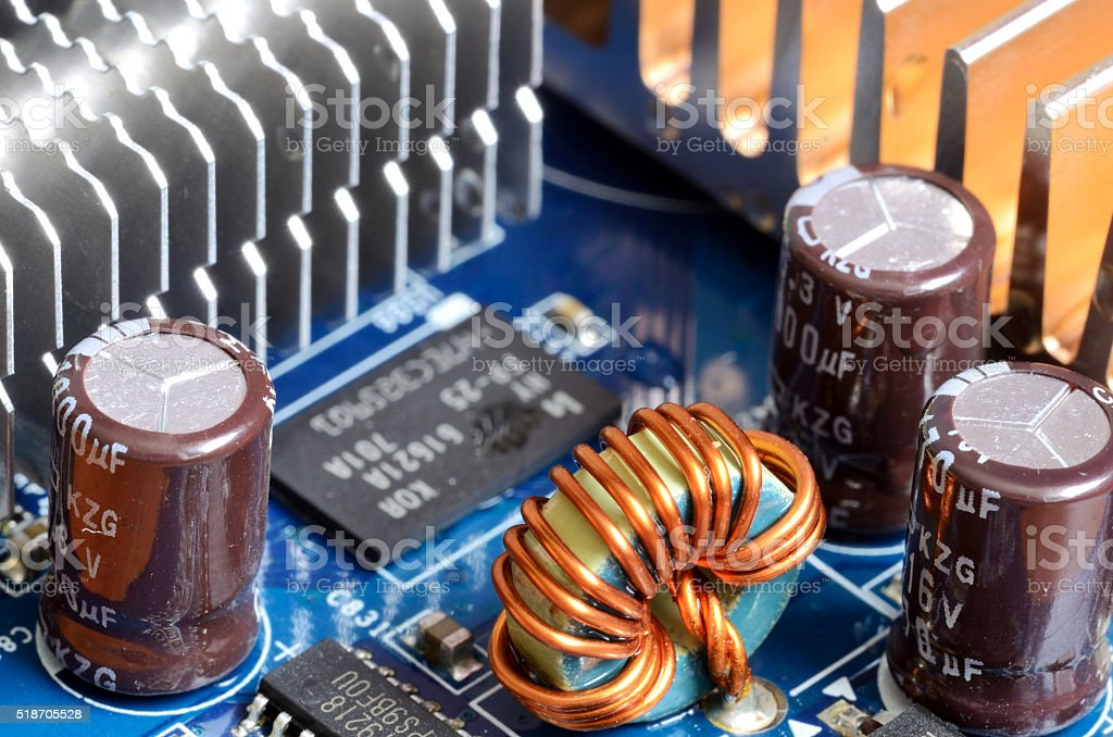 Close-up of inductors, capacitors, cooler and chips stock photo