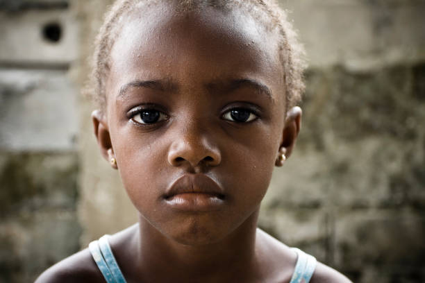 Close-up of innocent African girl with sad expression stock photo