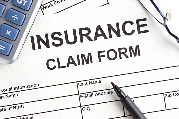 Close-up of Insurance claim form stock photo
