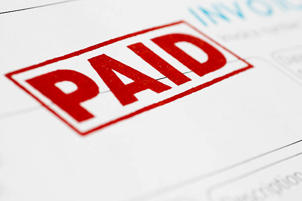 close-up of invoice stamped as paid in red - paid stock pictures, royalty-free photos & images