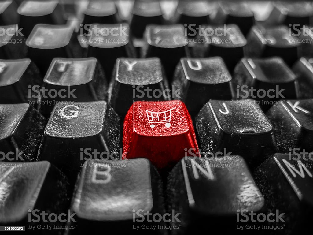 Close-up of isolated red key labeled shopping cart. stock photo
