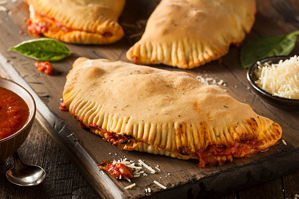 Close-up of Italian meat and cheese calzone stock photo