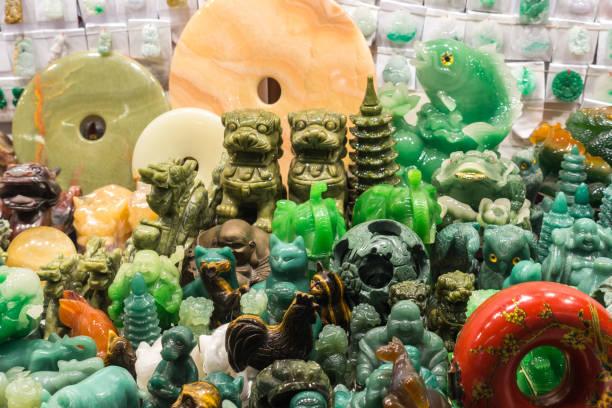 Close-up of Jade statues and souvenirs at the Jade Market, Hong Kong, Kowloon, Yau Ma Tei stock photo