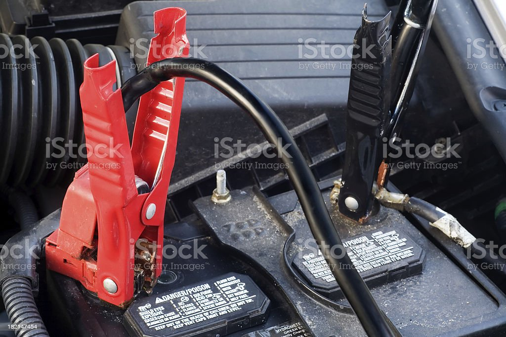 Closeup of Jumper Cables on Automobile Battery stock photo
