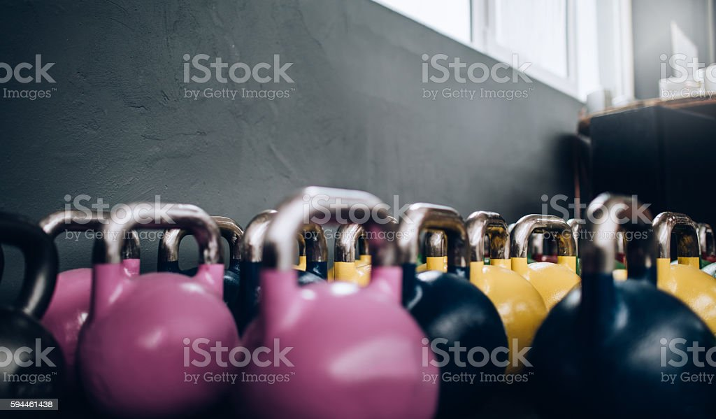 Close-up of Kettle Bells standing in gym Gym stock photo