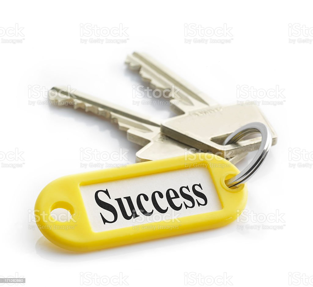 Close-up of keys on a yellow keychain labeled success stock photo