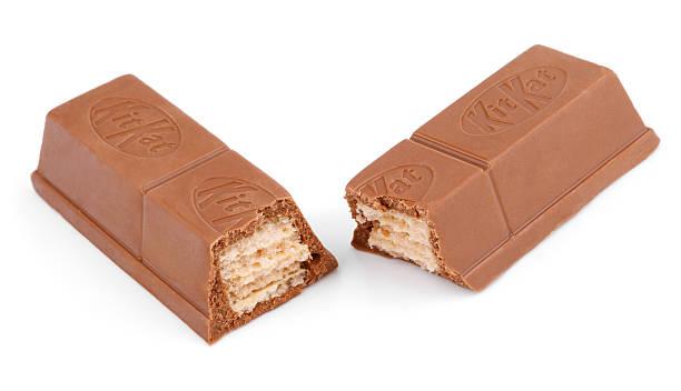 closeup of kit kat candy chocolate bar - kit kat stock photos and pictures