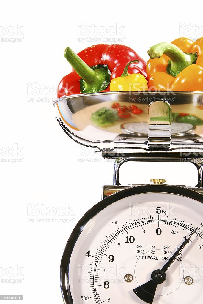 Closeup of kitchen scale with colored peppers royalty-free stock photo