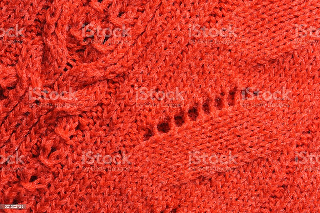 Closeup of knitted ornament on woolen texture foto stock royalty-free