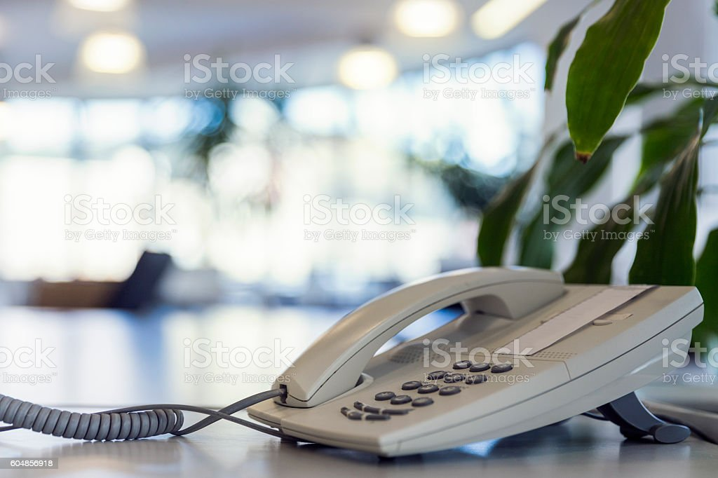 Close-up of landline phone on table at office stock photo