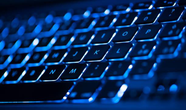 closeup of laptop keyboard illumination, backlit keyboard - neontasche stock-fotos und bilder