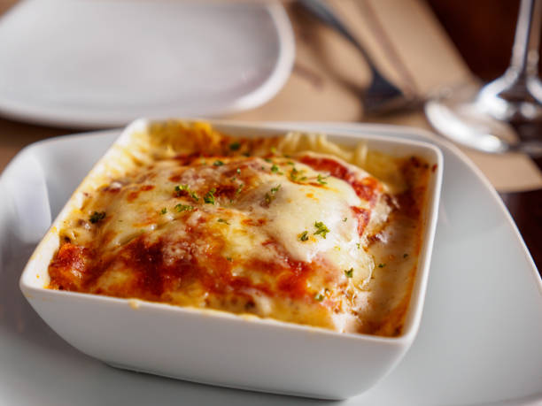Close-up of lasagna in white porcelain dish stock photo