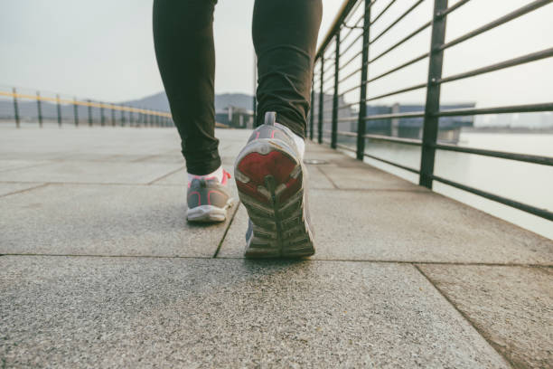 Closeup of legs in sport shoes going for a run stock photo