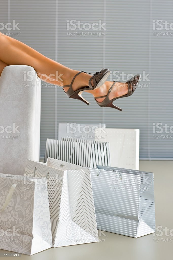 Closeup of legs with shopping bags royalty-free stock photo