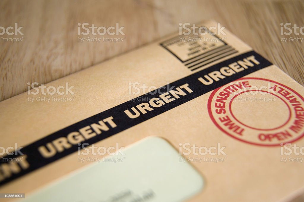 Close-up of letter with urgent stamp and label stock photo