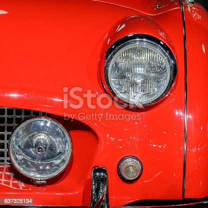 837409978istockphoto Closeup of light on red car. Beautiful modern red car 637325134