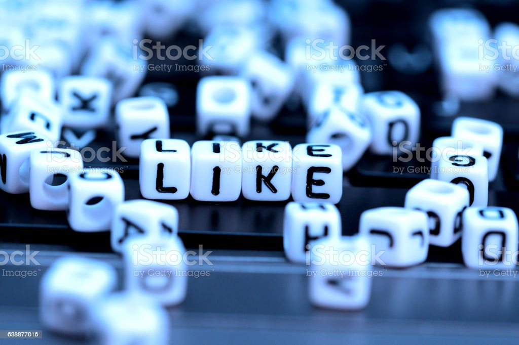 Close-up of Like word from white cubes on notebook stock photo