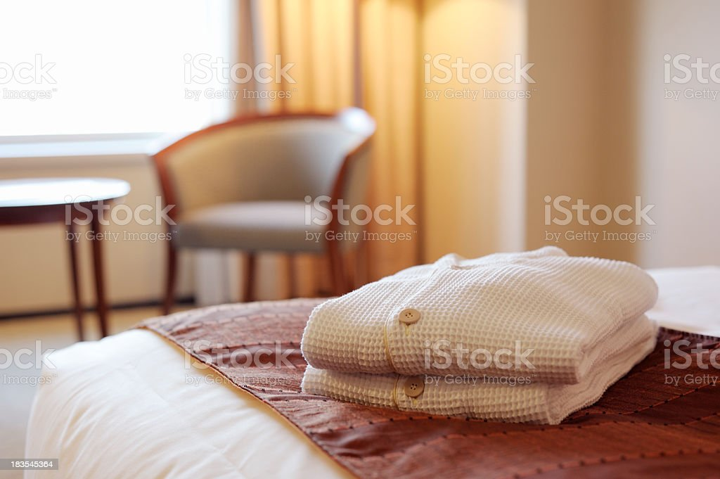Close-up of linens folded on the bed of a luxury hotel room royalty-free stock photo