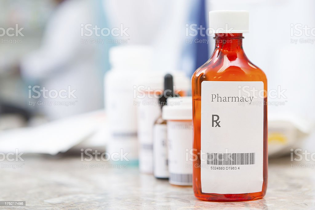 Closeup of liquid medicine bottle at a pharmacy royalty-free stock photo