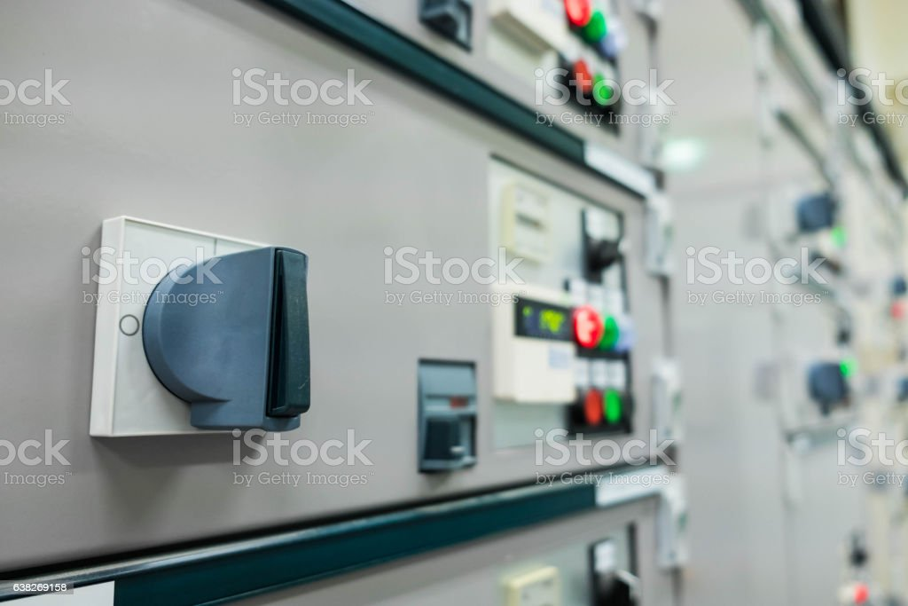 Closeup of lit lights and control dials on manufacturing stock photo