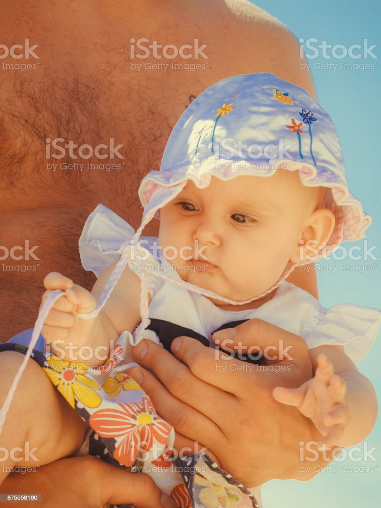 Closeup of little baby in parent hands. stock photo