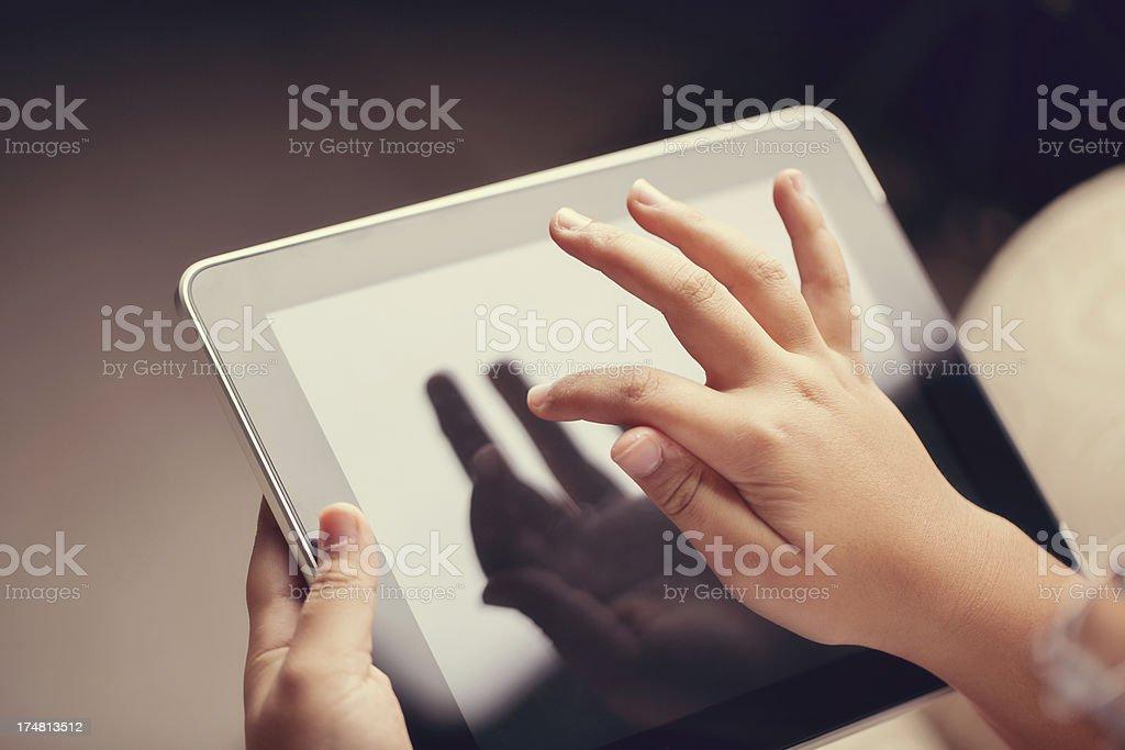 closeup of little boy using digital tablet royalty-free stock photo