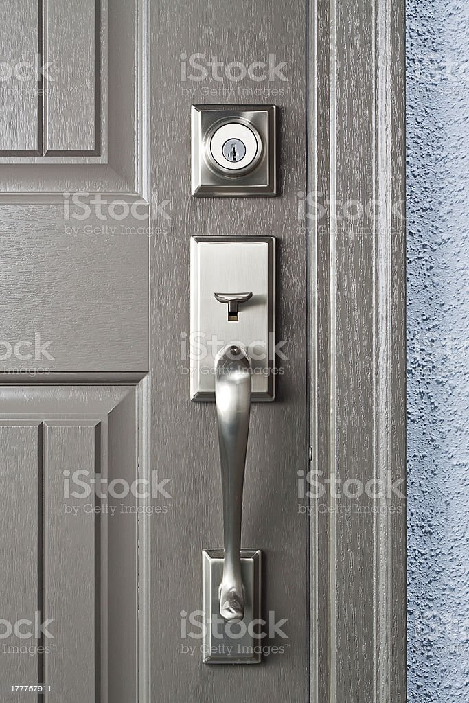 Close-up of locks on a gray door stock photo