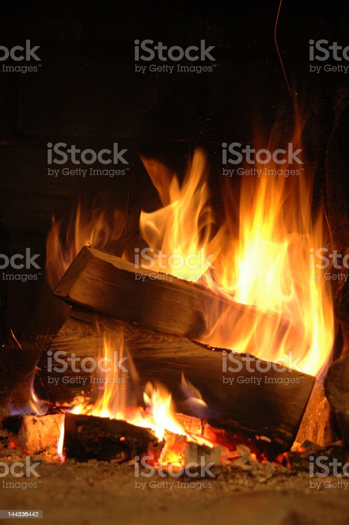 Close-up of logs on fire at night royalty-free stock photo