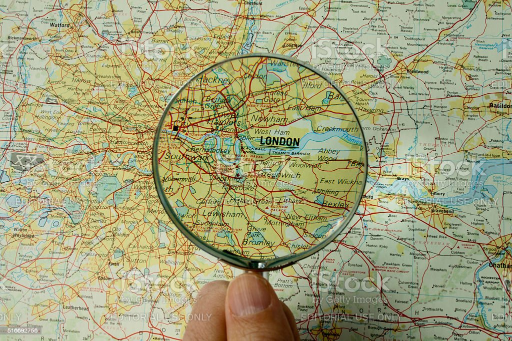 Closeup of London map with magnifying glass stock photo