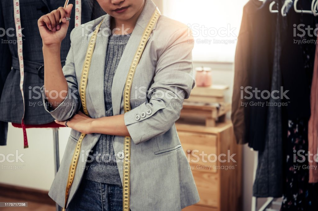 Closeup Of Lower Body Of Fashion Stylist Designer In Business Owner Workshop Tailor And Sewing Concept Portrait Of Happy Casual Trendy Fashion Designer Businesswoman In Studio Job And Occupation Stock Photo