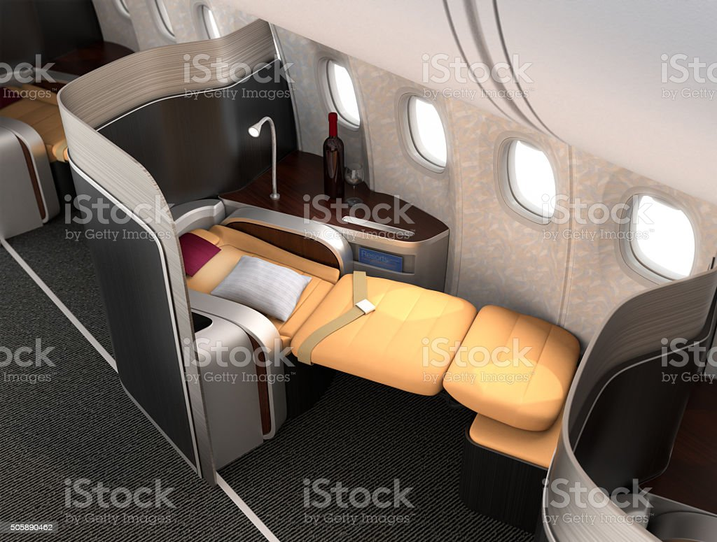 Close-up of luxurious business class seat with metallic silver partition stock photo