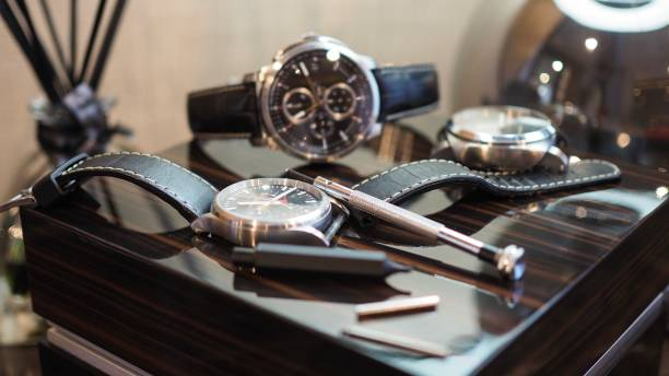 Closeup of luxury watches and tools.(Selected focus) Watches and leather straps with tools. luxury watch stock pictures, royalty-free photos & images