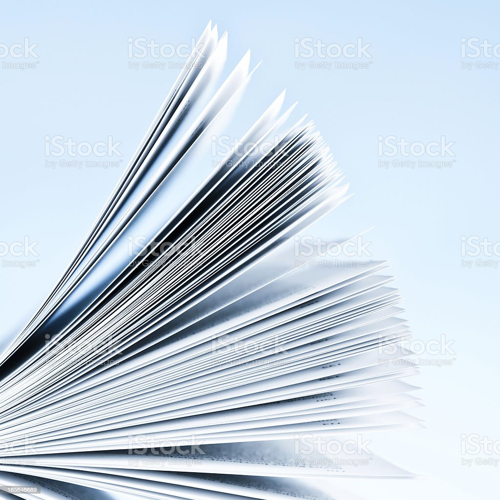 Close-up of magazine pages on light blue background stock photo
