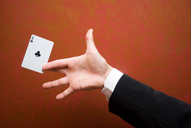 Close-up of magician performing trick with ace card Magician make performance with card magic trick stock pictures, royalty-free photos & images