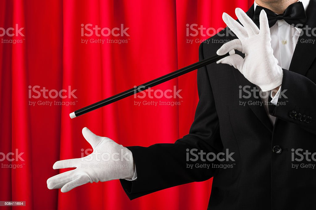 Close-up Of Magician Showing Trick stock photo