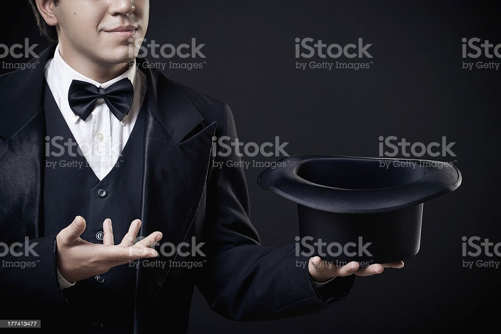 closeup of magician showing tricks with top hat isolated stock photo