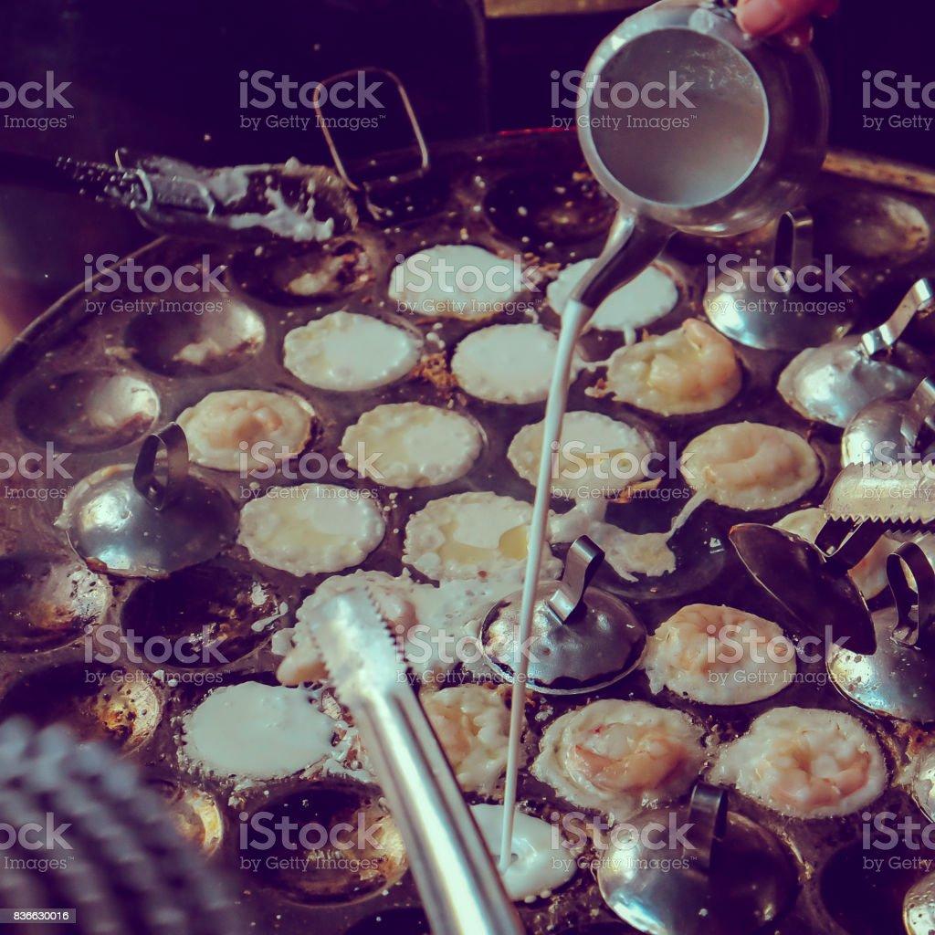Closeup of Making Vietnamese Savory Mini Pancakes or Banh Khot stock photo