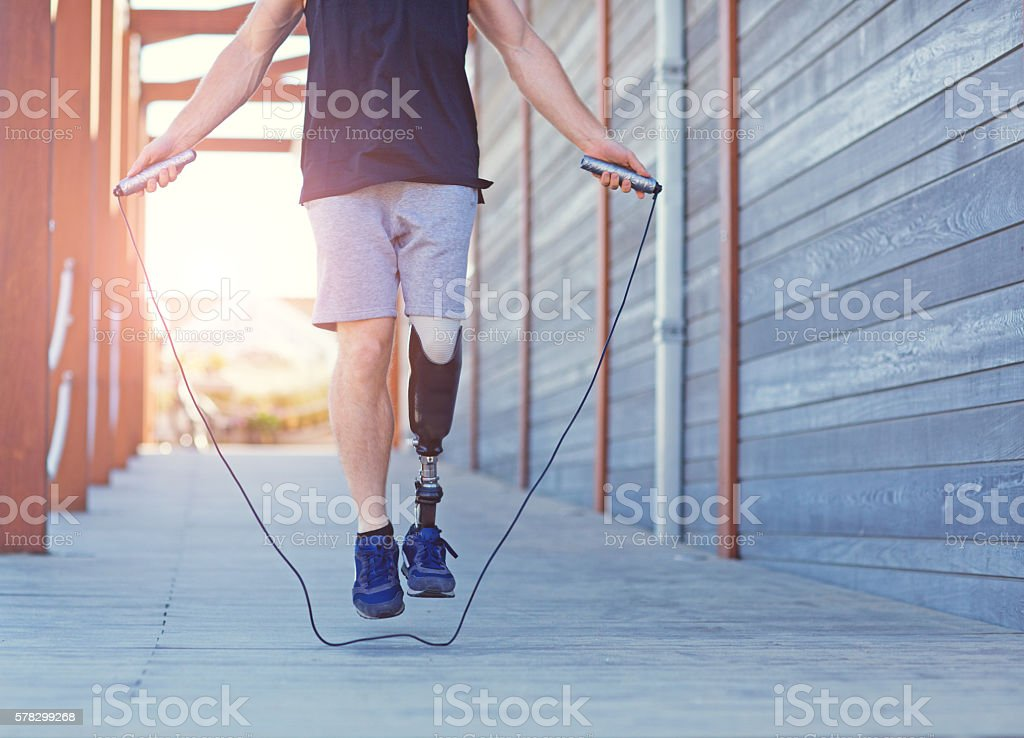 Close-up of male amputee's artificial limb during exercise stock photo