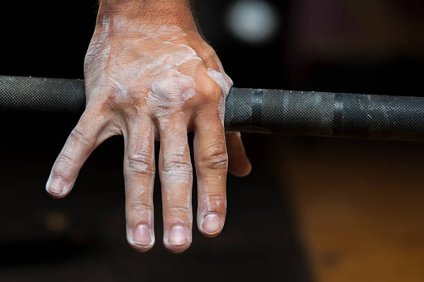 Closeup of male hand holding barbell stock photo