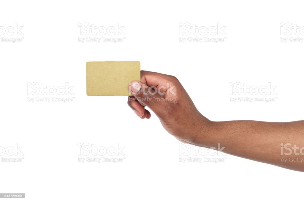 Close-up of male hand holding blank plastic card stock photo