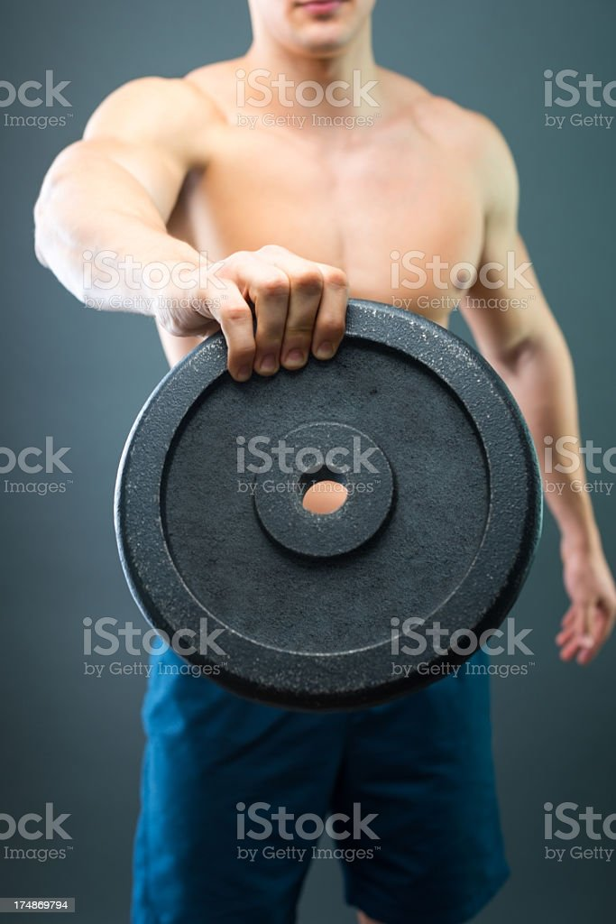 Close-up of male hand holding dumbbell . royalty-free stock photo